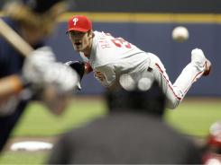 Philadelphia's Cole Hamels fires to the plate during his complete game victory over the Brewers Thursday in Milwaukee.