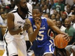 Kevin Durant, right, led the Washington, D.C.-based Goodman League to a 135-134 win over James Harden and the Los Angeles-based Drew League on Aug. 20.