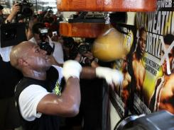 Floyd Mayweather has been able to block out the many distractions he faces daily to concentrate on his Sept. 17 welterweight title fight against Victor Ortiz.