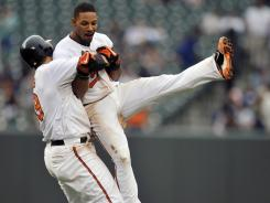 Baltimore's Robert Andino, right, is picked up by teammate Chris Davis after Andino drove in the game-winning run in the 10th inning to beat the New York Yankees.