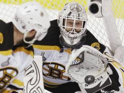 Tim Thomas, making a save for the Bruins during the Stanley Cup Final, was the league's best goalie last season and has set his goals even higher for this season.