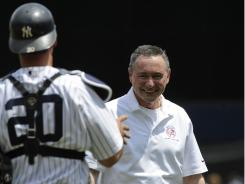 Longtime trainer Gene Monahan threw out the first pitch at the Yankees' Old Timers' Day.