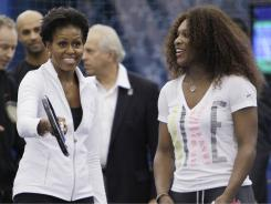 First lady Michelle Obama, left, and Serena Williams talk during a U.S. Open tennis clinic highlighting the importance of physical activity for kids.