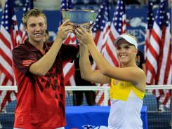 Jack Sock and Melanie Oudin of the USA pose with the trophy after defeating Eduardo Schwank and Gisela Dulko of Argentina in mixed doubles.