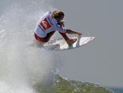 Owen Wright of Australia surfs his way to victory in the championship round of the Quiksilver Pro New York surfing tournament on Friday.