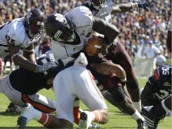 Mississippi State quarterback Chris Relf  is stopped short of the goal line by Auburn defensive back Ryan Smith  on the last play of the game.