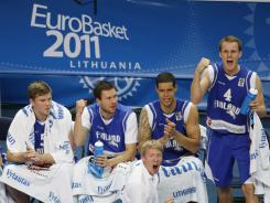 Members of Team Finland celebrate in the closing seconds of their 87-73 win over Georgia Saturday in the European Basketball Championships.