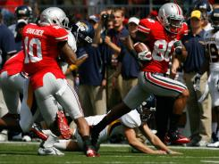 Ohio State's Chris Fields breaks free for a punt return for a touchdown late in the second quarter against Toledo.