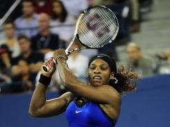 Serena Williams of the USA lashes a backhand during her victory Saturday against Caroline Wozniacki of Denmark in the U.S. Open semifinals.