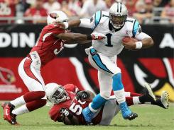 Cam Newton accounted for 422 passing yards and three total TDs in his NFL debut.