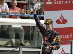 Red Bull driver Sebastian Vettel of Germany, celebrates on the podium after winning the Italian Formula One Grand Prix at the Monza racetrack on Sunday.