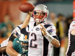 Tom Brady connected on his first eight passes en route to a franchise-record 517 yards passing in a season-opening win over the Dolphins.