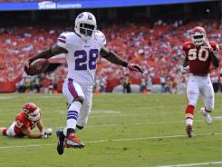 Bills running back C.J. Spiller (28) rushes in for a 9-yard touchdown against the Chiefs  as the Bills beat the Chiefs 41-7.
