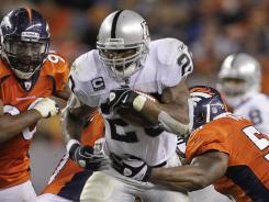 Darren McFadden (20) ran for 150 yards to help the Raiders make Hue Jackson a winner is his NFL head coaching debut.
