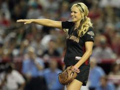 "Olympic softball player Jennie Finch's new book, ""Throw Like a Girl, How to Dream Big and Believe in Yourself,"" is part autobiography and part self-help."