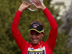 Geox-TMC team member Juan Cobo celebrates on the podium after his victory in the Spanish Vuelta in Madrid.
