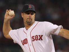 It took him eight attempts, but Red Sox pitcher Tim Wakefield finally earned his 200th career win on Tuesday.