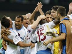 Trabzonspor players celebrate after the Turkish club's 1-0 road victory over Inter Milan in UEFA Champions League group play.
