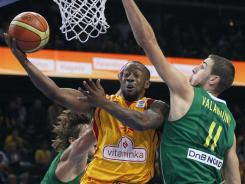 New Orleans-born Bo McCalebb, center, scored 23 points to lead Macedonia into the semifinals for the first time.