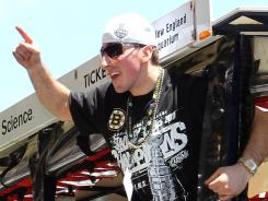 Brad Marchand reacts to cheers during the Bruins' Stanley Cup victory parade on June 18.