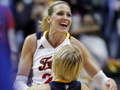 Katie Douglas, who led the Fever with 25 points, jumps into the arms of teammate Erin Phillips after Phillips hit a basket a the end of the second quarter during their win over the Liberty. Phillips also hit the game-winner for Indiana.