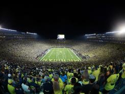 The first night game at Michigan Stadium proved to be a winner for ESPN.