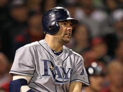 Casey Kotchman watches his two-run homer give Tampa Bay a 6-1 lead over Boston on Thursday. The Rays won 9-2 coming within three games of the Red Sox for the wild card spot.