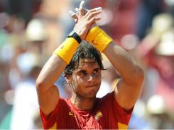 Spain's Rafael Nadal celebrates after winning his Davis Cup semifinal match against against France's Richard Gasquet in Cordoba, Spain, on Friday. Nadal has complained about the the overcrowded schedule.