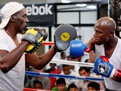 Floyd Mayweather  with his uncle and trainer Roger Mayweather, have trained hard to fight Saturday night after more than 16 months away from the ring.