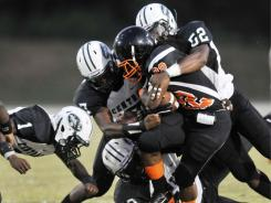 Cocoa's Antwan Lee had nowhere to go against the Miami Central defense on this play. Miami Central, ranked No. 17, shut out Cocoa 20-0 on Friday, improving to 2-0 on the season.