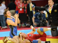 The United States' Ali Bernard, left, celebrates her victory over Kazhakstan's Guzel Manyurova to win the bronze medal match in the 158.5-pound division at the Senior Wrestling World Championship in Istanbul on Friday.