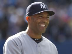 Mariano Rivera pitched a perfect ninth for the 601st save of his career, tying the all-time record.