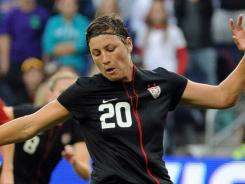 Abby Wambach slots home a penalty kick against Canada in the United States' 1-1 draw on Saturday.