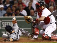 Tampa Bay Rays second baseman Ben Zobrist dodges the tag from Boston Red Sox catcher Jarrod Saltalamacchia during the seventh inning at Fenway Park. The Rays won 4-3.