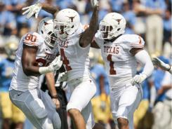 Kenny Vaccaro, celebrating an interception Saturday against UCLA, and Texas have opened 3-0 after going 5-7 last season.