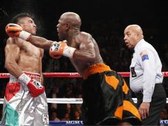 Floyd Mayweather Jr. lands a punch to Victor Ortiz during their WBC Welterweight bout in Las Vegas. The hit knocked out Ortiz, ending the fight in the fourth round.