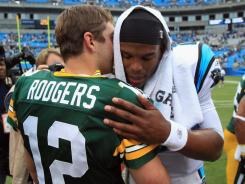 Aaron Rodgers and Cam Newton combined for 740 passing yards Sunday with Newton throwing for a rookie record 432.