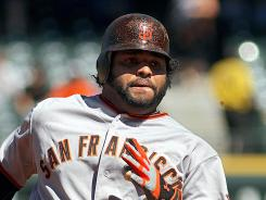 Pablo Sandoval homered twice in an eight-run fourth inning as the San Francisco Giants thumped the Colorado Rockies 12-5 Sunday.