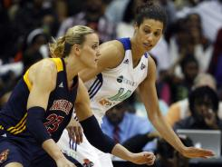 The Fever's Katie Douglas (23) dribbles as the Liberty's Nicole Powell (14) tries to block her path during the second half of their Eastern Conference semifinal game in Newark, N.J.  Powell had 19 points in Liberty's 87-72 win. Douglas scored 20 for the Fever.