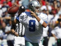 Tony Romo didn't let a fractured rib stop him from throwing for 345 yards and two touchdowns in the Cowboys' overtime win.