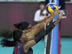 USA players Destinee Hooker and Foluke Akinradewo during the women's volleyball grand prix against Brazil in August..