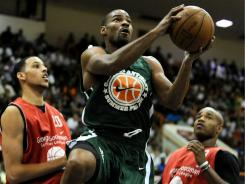 Gary Neal drives to the hoop during Goodman League action Aug. 30 in Baltimore.