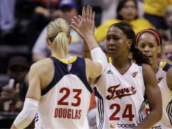 The Fever's Katie Douglas and Tamika Catchings celebrate during the second half of the team's 72-62 Game 3 win over the Liberty, which clinched a spot in the Eastern Conference finals.