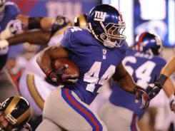 Ahmad Bradshaw (44) ran for 59 yards to help the Giants win their home opener on Monday night.