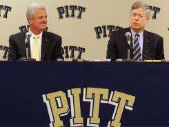 University of Pittsburgh athletic director Steve Pederson, left, and Chancellor Mark Nordenberg speak during a press conference following Pittsburgh's acceptance into the Atlantic Coast Conference.