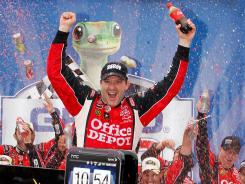 Tony Stewart kept alive his streak of seasons with at least one win, moving it to 13 by capturing Monday's Geico 400.