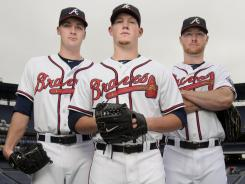 Atlanta relievers (left to right)  Eric O'Flaherty, Craig Kimbrel and Jonny Venters have kept the Braves in the playoff hunt.