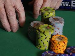 Poker chips are shown on a poker table.