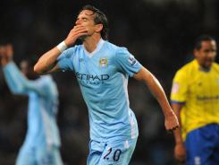 Owen Hargreaves celebrates scoring his goal in Manchester City's third-round League Cup victory over Birmingham. It was the England international's first competitive match for City since joining the club from Manchester United.
