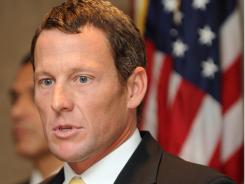 In this file photo from Feb. 28, 2011, Lance Armstrong  gives a press conference in Los Angeles.